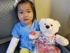 Molly Kate posing with a bear given to her by Carter\'s 8U baseball team